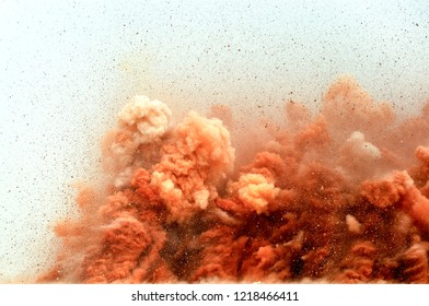 The particles of the brown stones in the air after the blast