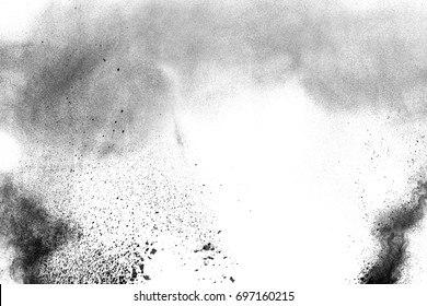 particles of charcoal splatted on white background