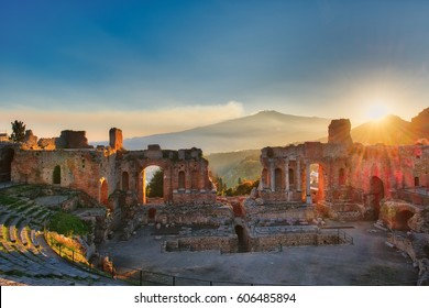 Particular of Ancient theatre of Taormina  Sicily Italy with Etna  erupting volcano at sunse