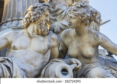 A particular of Athena Fountain (Pallas-Athene-Brunnen) in front of Austrian Parliament Building. Figures symbolize most important rivers of the Austro-Hungarian Empire. It was completed in 1902.