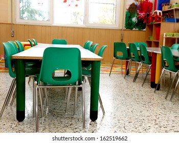 particular of a classroom in a kindergarten with little green chairs