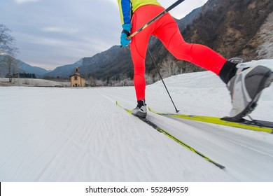 Particular of Cross-country skiing classic technique  practiced by woman
