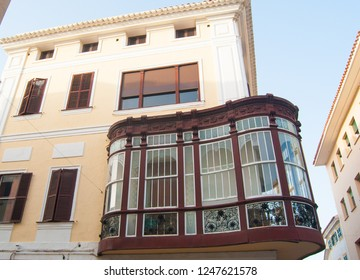 Particular house with curved and covered balcony in the capital of the island of Menorca
