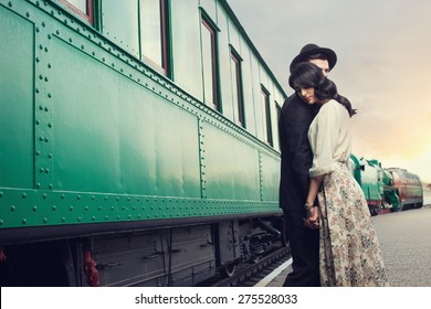 parting of lovely couple on railway station