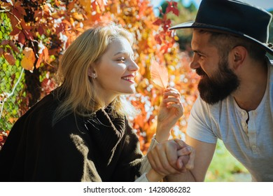 Parting with sweetheart. Bearded hipster man and tender blonde woman in love. Couple in love happy close up nature background defocused. Love in air. Lovely couple smiling each other. True feelings.