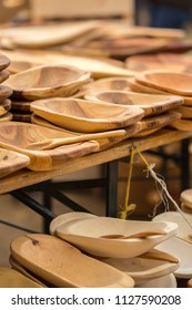 Partizanska Lupca , SLOVAKIA-JUNE 30,2018: Utgard - Early Medieval Festival. Folk production hand carved of wooden plates, bowls and dishes.