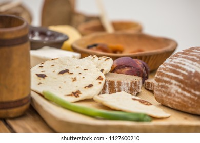 Partizanska Lupca , SLOVAKIA-JUNE 30,2018: Utgard - Early Medieval Festival. A sample of medieval dining. Food on a wooden rustic table.