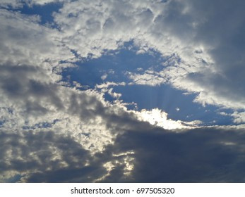 partly cloudy background sunlight rays