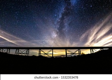 Partly Cloudy Milky Way Over the Abandoned Eagle Mountain Railroad (EMRR) Trestle.