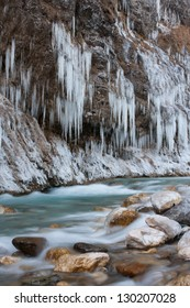 Partly frozen river Kokra in Slovenia.