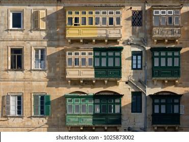 Partly renewed balconies on buildings in Valletta, Malta.