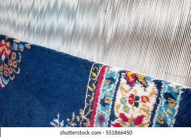 Partly woven carpet, rug on a loom shows wool pile, foundation, warp and weft