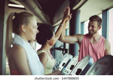 Partner in fitness. People at gym.