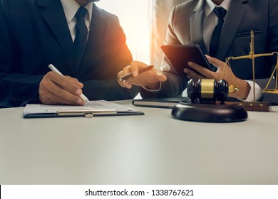 Partner lawyers or attorneys discussing a contract agreement. Successful businessmen have a contract in place to protect it,signing of modest agreements form in office ...