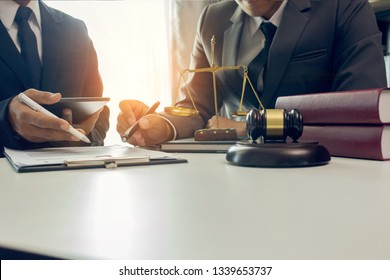 Partner lawyers or attorneys discussing a contract agreement. Successful businessmen have a contract in place to protect it,signing of modest agreements form in office