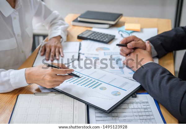 Partner meeting of business team colleagues consultation and discussion marketing plan meeting concept on financial report and analyzing investment project to development grow to success.