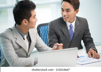 Partners with positive attitude agreeing upon certain business issues