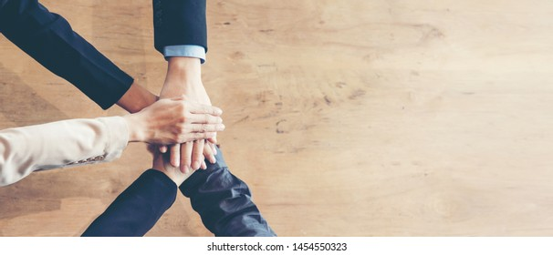 Partners Team work joining hands to success together. Business Team stack of hands for star up project, copy space for text banner.  Team work Concept
