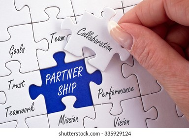 Partnership Business Concept with female hand and puzzle