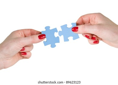 partnership concept. two hands with different pieces of puzzle