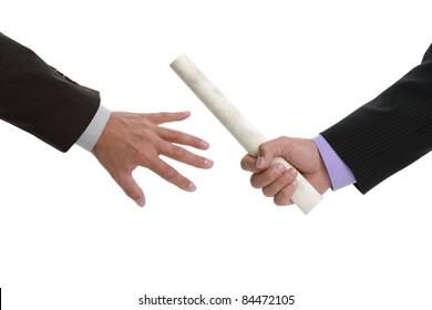 Partnership or teamwork concept two men handing over a paaperwork baton