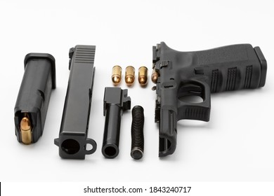 Parts of automatic pistol handgun with magazine on white isolated background