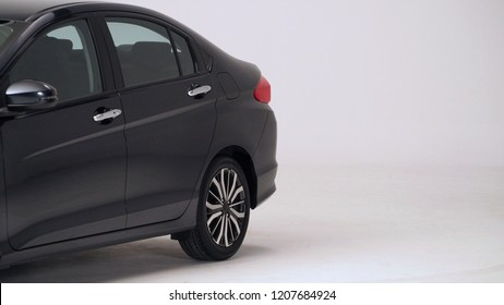 Parts of automotive car black color such as window, wheel, lamp, mirror, side shots shooting from front and rear on white background in studio production and for use in automobile industry.