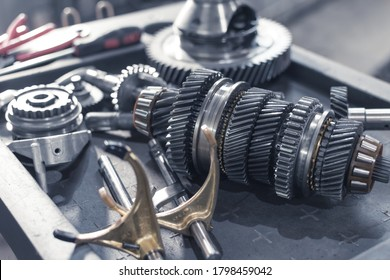 parts of an automotive manual transmission on a table in a car service. Close up