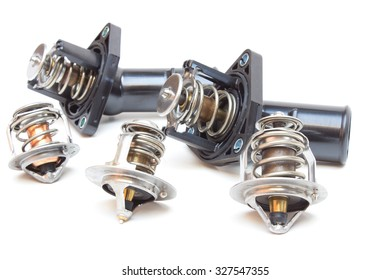 Parts of the car engine. Thermostat engine cooling system of the internal combustion machine. Spare parts on a white background