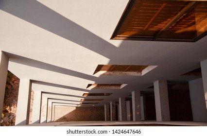 Parts of a concrete building with shadows of sunlight unique photo