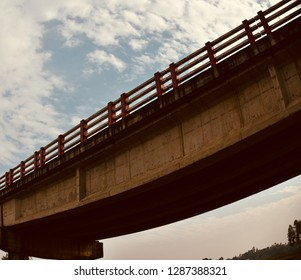 Parts of a concrete made traditional bridge with sky background photo