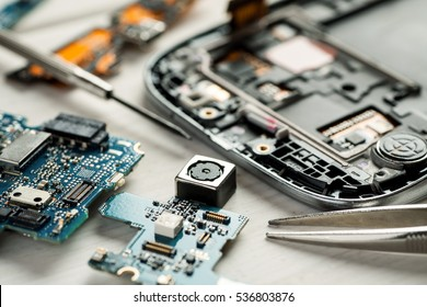 Parts of digital gadgets with tools. Repair and service concept.