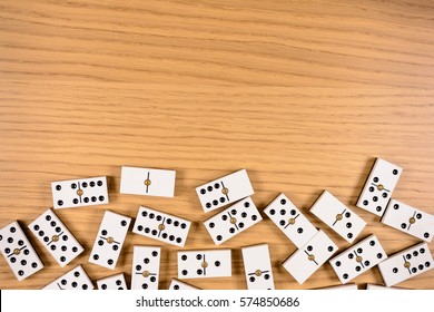 parts of game of domino on wood with space for text