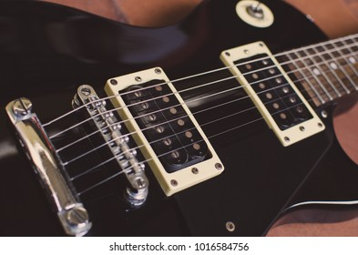 Parts of a guitar, bridge and pickups