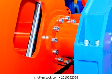 Parts of the industrial machinery, machine tools of red and blue color. Macro shooting