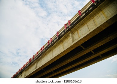 Parts of a long architectural highway bridge with sky background photo