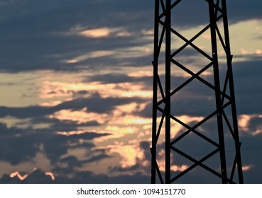 Parts of a metallic electricity tower isolated with sky background unique photo