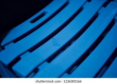 Parts of a plastic chair isolated unique blue object photo