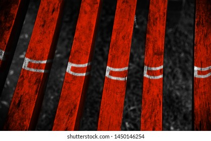 Parts of a red wooden bench with white textures unique photo