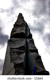 Parts of a tower-like monument. The idea of the picture is a god-like monument, with a touch to the sky. The lowkey lighting goes in hands with the cloudy sky, while the touch of blue brings a 'non-B&W' effect.