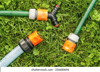 Parts of a water sprinkler system on the garden grass