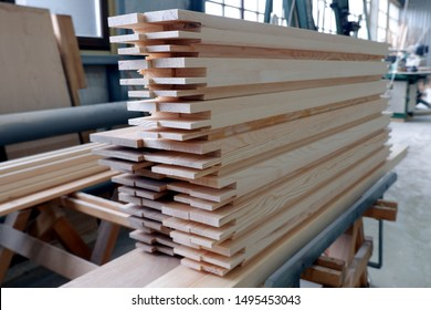 Parts of wooden windows from glued beams from pine with chopped mortise and tenon joints. Close up view, selective focus.