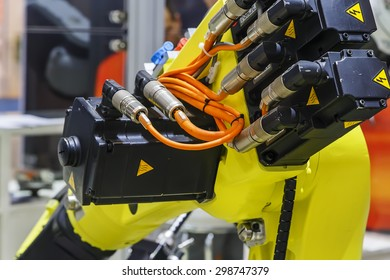 parts of a yellow industrial robot closeup