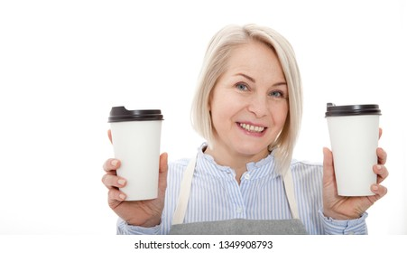 Part-time job coffee break relax leisure pause concept. Friendly pleasant woman barista giving two big latte isolated on gray background copy-space. Mock up for use