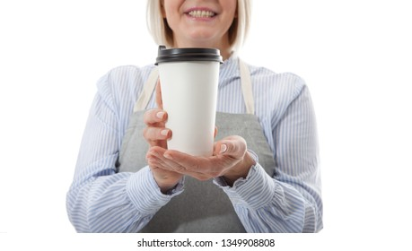 Part-time job coffee break relax leisure pause concept. Friendly pleasant woman barista giving big latte isolated on gray background copy-space. Mock up for use