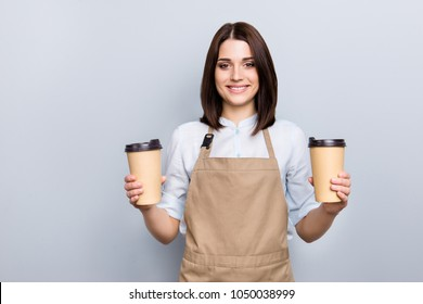 Part-time job person owner cacao routine lifestyle rest break relax leisure pause concept. Portrait of kind friendly pleasant girl giving two big latte isolated on gray background copy-space