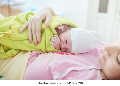 parturition, young woman with newborn