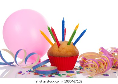 Party accessories with cupcake, garland and balloon over white background