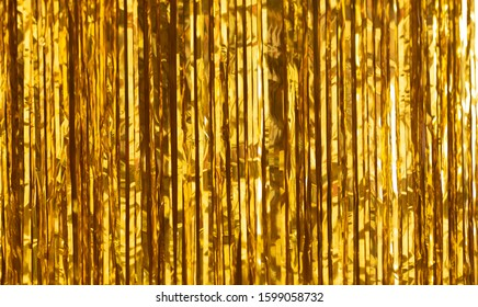 Party Background. Decor made of gold foil, tinsel and candy. Festive and cheerful mood.