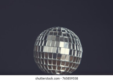 Party background. Disco mirrorball against a black background